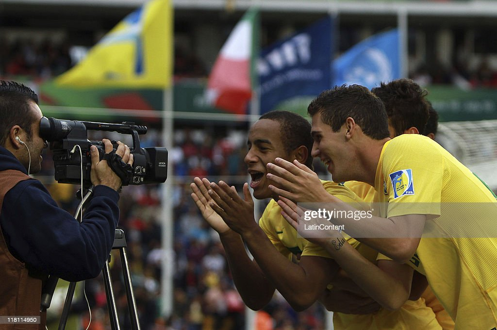 Ademilson of Brazil celebrates a scored goal with teamates during the FIFA U17 World Cup Mexico 2011 Quarter Final match between Japan and Brazil at the La Corregidora Stadium on July 3, 2011 in Queretaro, Mexico.