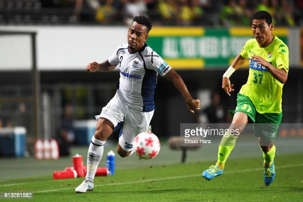 Ademilson of Gamba Osaka and Kim Byeom Yong of JEF United Chiba compete for the ball during the 97th Emperor's Cup third round match between JEF...