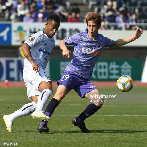 Ademilson of Gamba Osaka and Sho Sasaki of Sanfrecce Hiroshima compete for the ball during the J.League J1 match between Sanfrecce Hiroshima and...