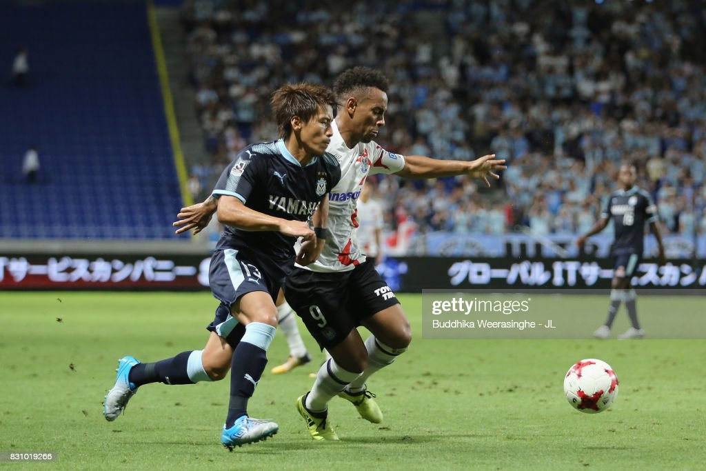 Ademilson of Gamba Osaka and Tomohiko Miyazaki of Jubilo Iwata compete for the ball during the J.League J1 match between Gamba Osaka and Jubilo Iwata at Suita City Football Stadium on August 13, 2017 in Suita, Osaka, Japan.