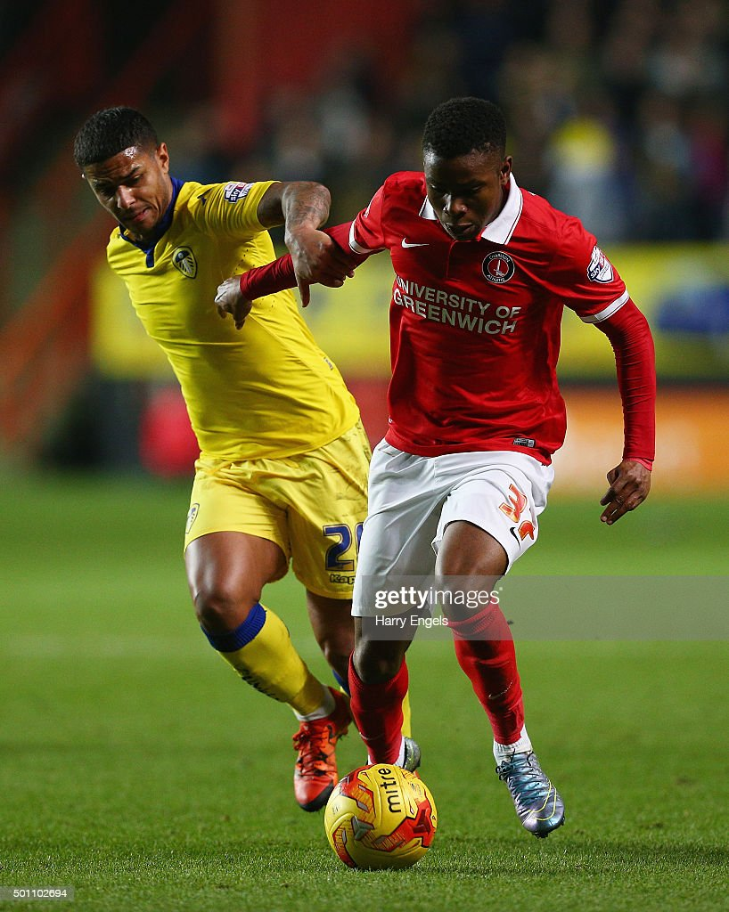 Ademola Lookman (R) and Liam Bridcutt of Leeds compete for the ball during the Sky Bet Championship match between Charlton Athletic and Leeds United at The Valley on December 12, 2015 in London, United Kingdom.