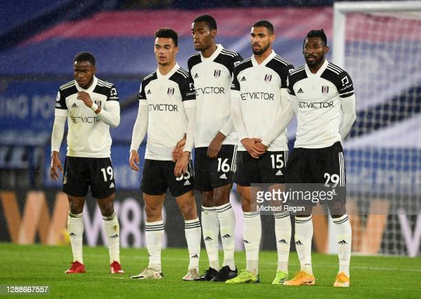 Ademola Lookman , Antonee Robinson , Tosin Adarabioyo , Ruben Loftus-Cheek and Andre-Frank Zambo Anguissa of Fulham look on during a line up during...