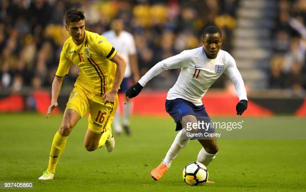 Ademola Lookman of England gets past Dragos Nedelcu of Romania during the International Friendly between England U21 and Romania U21 at Molineux on...