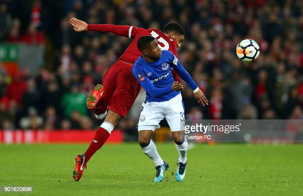 Ademola Lookman of Everton battles with Joe Gomez of Liverpool during the Emirates FA Cup third round match between Liverpool and Everton at Anfield...