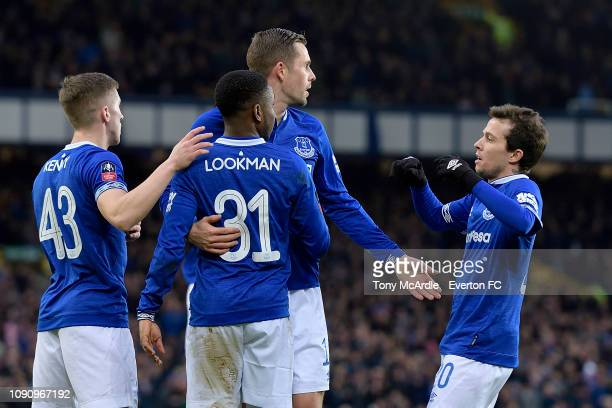 Ademola Lookman of Everton celebrates his goal with Gylfi Sigurdsson and Bernard during the Emirates FA Cup Third Round match between Everton and...