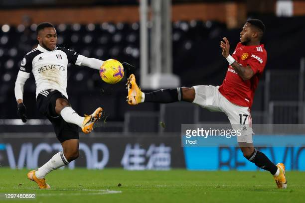 Ademola Lookman of Fulham and Fred of Manchester United battle for possession during the Premier League match between Fulham and Manchester United at...