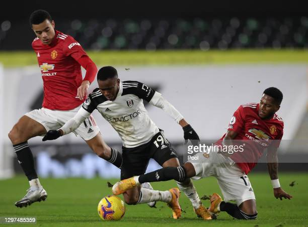 Ademola Lookman of Fulham battles for possession with Mason Greenwood and Fred of Manchester United during the Premier League match between Fulham...