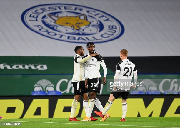 Ademola Lookman of Fulham celebrates after scoring their team's first goal with Andre-Frank Zambo Anguissa of Fulham and Harrison Reed of Fulham...