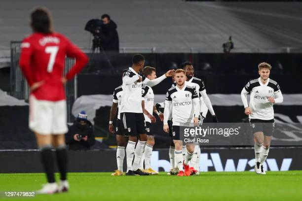 Ademola Lookman of Fulham celebrates with team mates after scoring their side's first goal during the Premier League match between Fulham and...