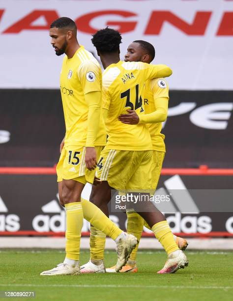 Ademola Lookman of Fulham celebrates with teammates after scoring his team's first goal during the Premier League match between Sheffield United and...