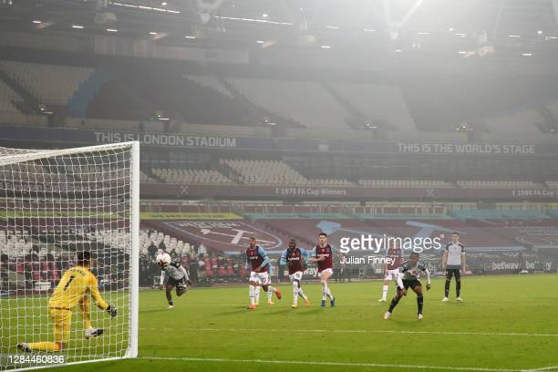 Ademola Lookman of Fulham has his penalty saved by Lukasz Fabianski of West Ham United during the Premier League match between West Ham United and...
