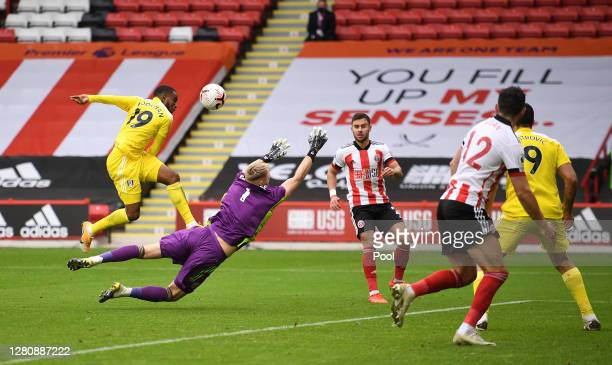 Ademola Lookman of Fulham is challenged by Aaron Ramsdale of Sheffield United during the Premier League match between Sheffield United and Fulham at...