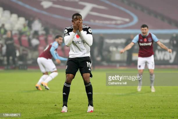 Ademola Lookman of Fulham reacts after missing a penalty during the Premier League match between West Ham United and Fulham at London Stadium on...