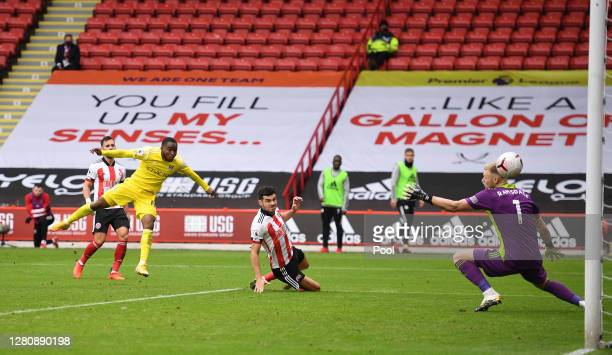 Ademola Lookman of Fulham scores his team's first goal past Aaron Ramsdale of Sheffield United during the Premier League match between Sheffield...