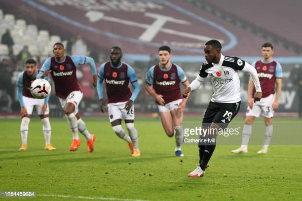 Ademola Lookman of Fulham takes a penalty which is later saved during the Premier League match between West Ham United and Fulham at London Stadium...