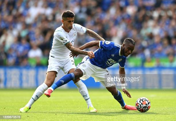 Ademola Lookman of Leicester City battles for possession with Joao Cancelo of Manchester City during the Premier League match between Leicester City...