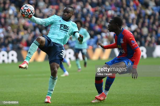 Ademola Lookman of Leicester City is challenged by Tyrick Mitchell of Crystal Palace during the Premier League match between Crystal Palace and...