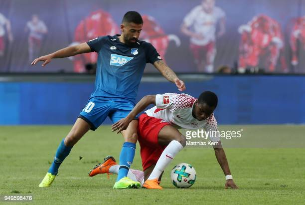 Ademola Lookman of Leipzig battles for the ball with Kerem Demirbay of Hoffenheim during the Bundesliga match between RB Leipzig and TSG 1899...