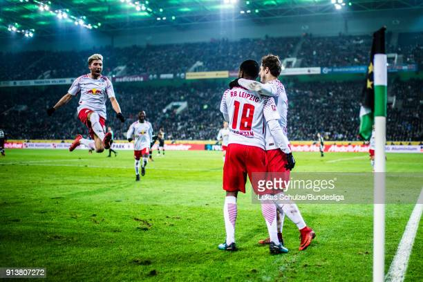 Ademola Lookman of Leipzig celebrates his teams first goal with Kevin Kampl and team mates during the Bundesliga match between Borussia...