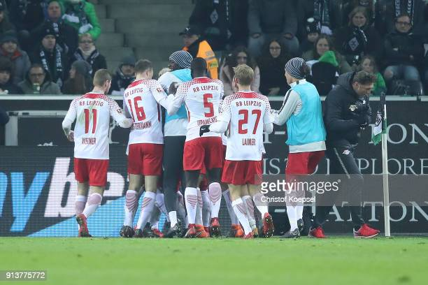 Ademola Lookman of Leipzig celebrates wit his team and coach Ralph Hasenhuettl of Leipzig after he scored a goal to make it 0:1 during the Bundesliga...