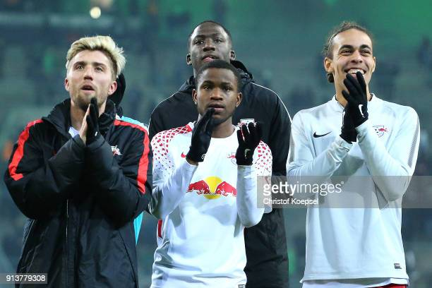 Ademola Lookman of Leipzig celebrates with his team in front of their supporters after the Bundesliga match between Borussia Moenchengladbach and RB...