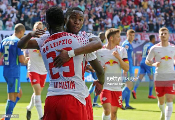 Ademola Lookman of Leipzig jubilates with team mate Jean Kevin Augustin after scoring the first goal during the Bundesliga match between RB Leipzig...