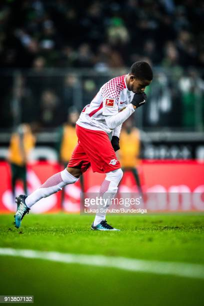 Ademola Lookman of Leipzig kisses his hand after his substitutes during the Bundesliga match between Borussia Moenchengladbach and RB Leipzig at...