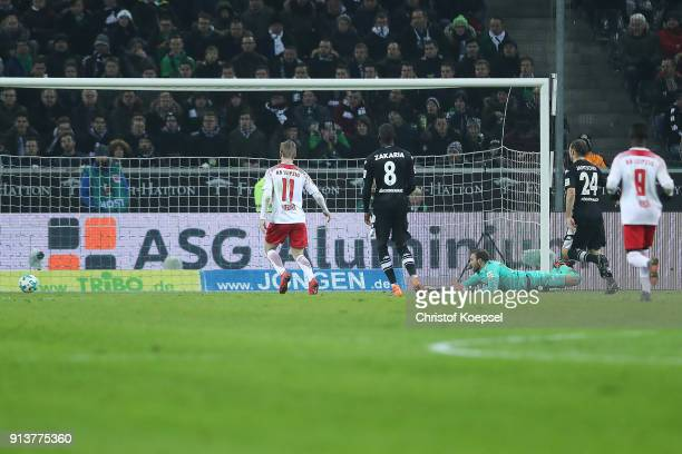 Ademola Lookman of Leipzig scores a goal to make it 0: 1 past goalkeeper Tobias Sippel of Moenchengladbach during the Bundesliga match between...