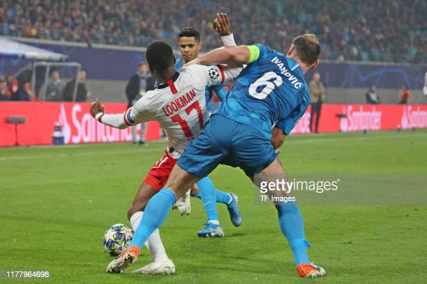 Ademola Lookman of RB Leipzig and Branislav Ivanovic of Zenit St Petersburg battle for the ball during the UEFA Champions League group G match...