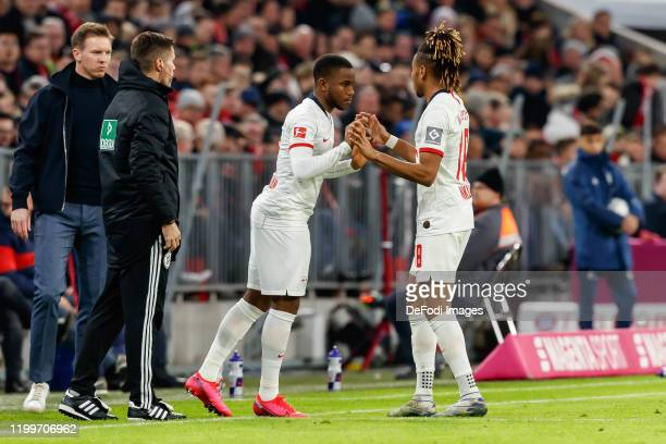Ademola Lookman of RB Leipzig and Christopher Nkunku of RB Leipzig substitutes during the Bundesliga match between FC Bayern Muenchen and RB Leipzig...
