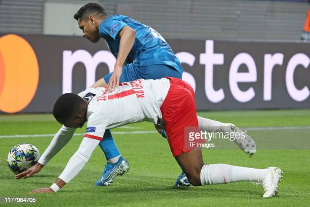 Ademola Lookman of RB Leipzig and Douglas Santos of Zenit St Petersburg battle for the ball during the UEFA Champions League group G match between RB...