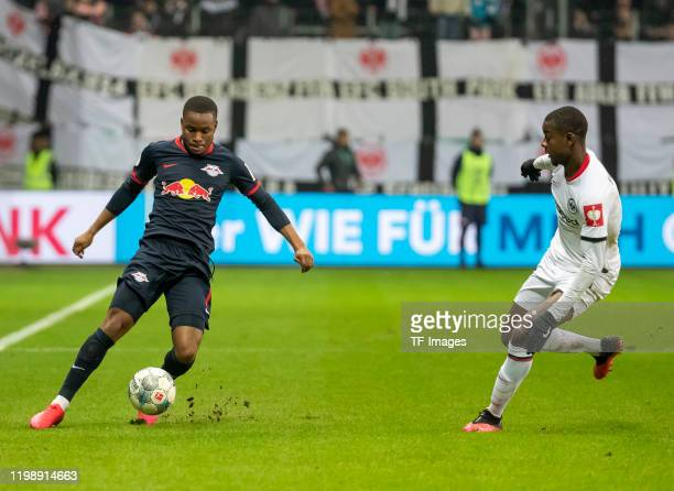 Ademola Lookman of RB Leipzig and Evan NDicka of Eintracht Frankfurt during the DFB Cup round of sixteen match between Eintracht Frankfurt and RB...