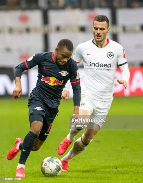 Ademola Lookman of RB Leipzig and Filip Kostic of Eintracht Frankfurt during the DFB Cup round of sixteen match between Eintracht Frankfurt and RB...