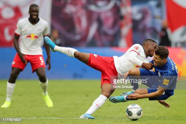 Ademola Lookman of RB Leipzig battles for possession with Alessandro Schopf of FC Schalke 04 during the Bundesliga match between RB Leipzig and FC...