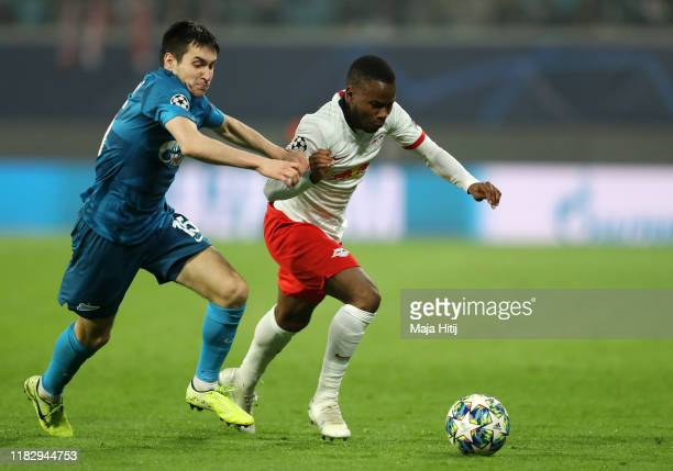 Ademola Lookman of RB Leipzig battles for possession with Vyacheslav Karavaev of Zenit St Petersburg during the UEFA Champions League group G match...