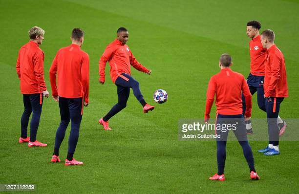 Ademola Lookman of RB Leipzig controls the ball as his team mates look on during the RB Leipzig Training Session on the eve of the UEFA Champions...