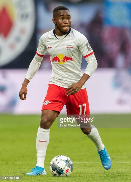 Ademola Lookman of RB Leipzig runs with the ball during the Bundesliga match between RB Leipzig and FC Schalke 04 at Red Bull Arena on September 28...
