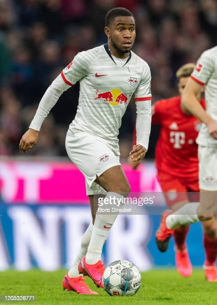 Ademola Lookman of RB Leipzig runs with the ball during the Bundesliga match between FC Bayern Muenchen and RB Leipzig at Allianz Arena on February...