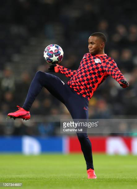 Ademola Lookman of RB Leipzig warms up prior to the UEFA Champions League round of 16 first leg match between Tottenham Hotspur and RB Leipzig at...