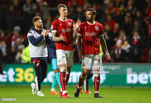 Aden Flint and Marlon Pack of Bristol City looks dejected in defeat after the Carabao Cup semifinal second leg match between Bristol City and...