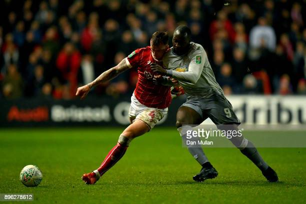 Aden Flint of Bristol City battles for possesion with Romelu Lukaku of Manchester United during the Carabao Cup QuarterFinal match between Bristol...