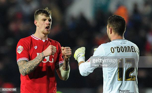 Aden Flint of Bristol City celebrates victory with Richard O'Donnell of Bristol City during the Sky Bet Championship match between Bristol City and...