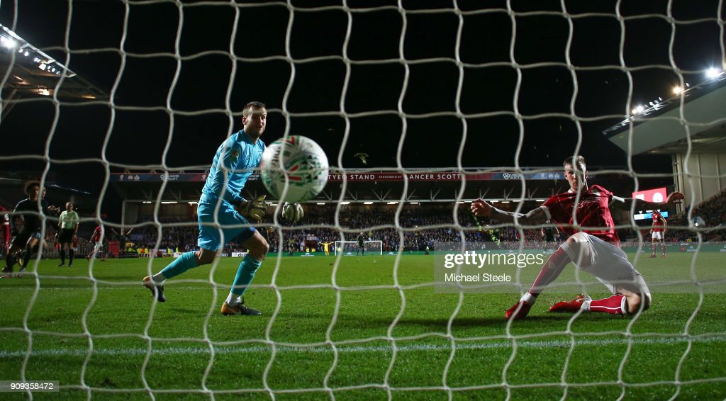 Aden Flint of Bristol City fails to stop Leroy Sane of Manchester City (L) as he scores their first goal during the Carabao Cup semi-final second leg match between Bristol City and Manchester City at Ashton Gate on January 23, 2018 in Bristol, England.