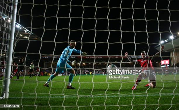 Aden Flint of Bristol City fails to stop Leroy Sane of Manchester City as he scores their first goal during the Carabao Cup semifinal second leg...