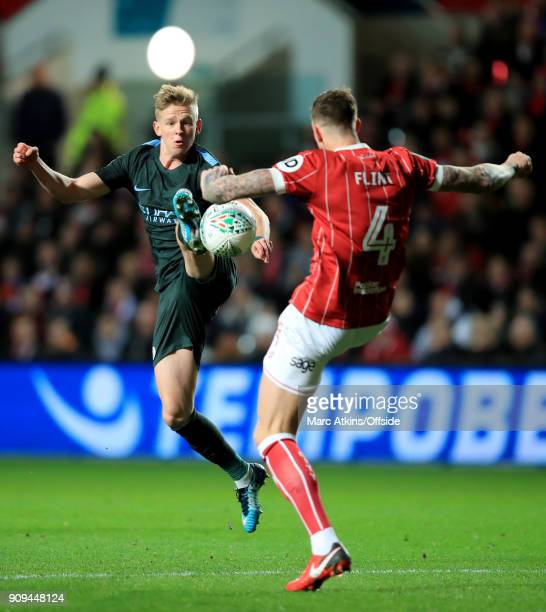 Aden Flint of Bristol City in action with Oleksandr Zinchenko of Manchester City during the Carabao Cup SemiFinal 2nd leg match between Bristol City...
