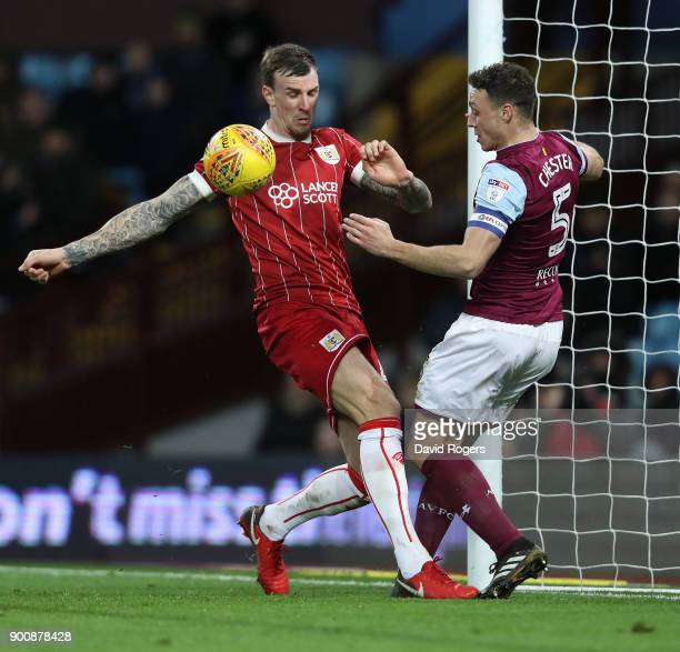 Aden Flint of Bristol City is challenged by James Chester during the Sky Bet Championship match between Aston Villa and Bristol City at Villa Park on...