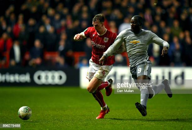 Aden Flint of Bristol City is challenged by Romelu Lukaku of Manchester United during the Carabao Cup QuarterFinal match between Bristol City and...