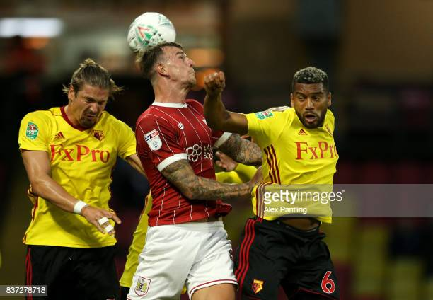 Aden Flint of Bristol City is challenged by Sebastian Prodl and Adrian Mariappa of Watford during the Carabao Cup Second Round match between Watford...