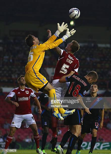 Aden Flint of Bristol City is sandwiched between Neil Alexander and Aaron Wilbraham of Crystal Palace during the Capital One Cup second round match...