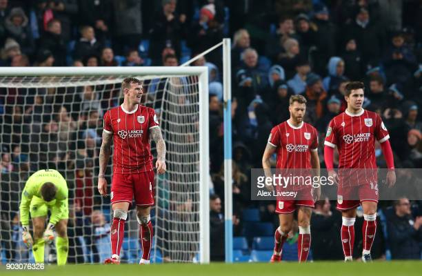 Aden Flint of Bristol City looks dejected alongside team mates as Sergio Aguero of Manchester City scores their second goal during the Carabao Cup...